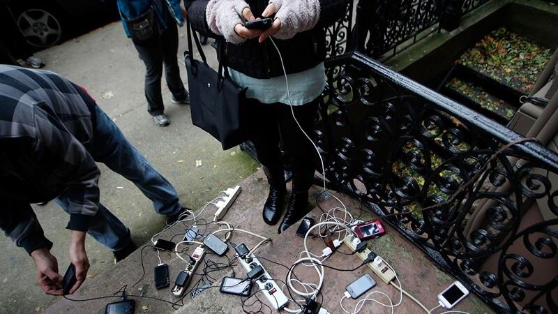poeple charging